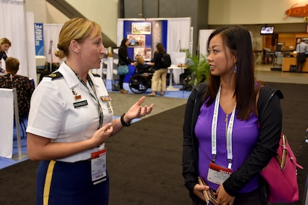 Staff Sgt. Shanna M. Rodriguez, health care recruiter with the San Francisco Medical Recruiting Station, speaks with an attendee of the American Psychological Association 2018 Convention at the Moscone Center in San Francisco, California on August 9. Rodriguez was on hand with Soldiers from her station to explain the benefits and opportunities of a career in Army Medicine. For more information on the Army's more than 90 medical specialties go to healthcare.goarmy.com.