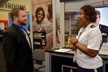 Maj. Lakishia M. Simmons, San Francisco Medical Recruiting Station officer-in-charge, speaks with an attendee of the American Psychological Association 2018 Convention at the Moscone Center in San Francisco, California on August 9. Simmons was on hand with her team to explain the benefits and opportunities of a career in Army Medicine. For more information on the Army's more than 90 medical specialties go to healthcare.goarmy.com.