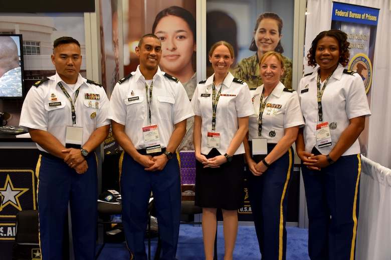 U.S. Army medical recruiters and subject matter experts at the American Psychological Association 2018 Convention at the Moscone Center in San Francisco, California on August 9. From left to right; Sgt. 1st Class Anthony M. Foronda, Lt. Col. Joseph H. Afanador, Capt. Emily Burris, Staff Sgt. Shanna M. Rodriguez, and Maj. Lakishia M. Simmons.