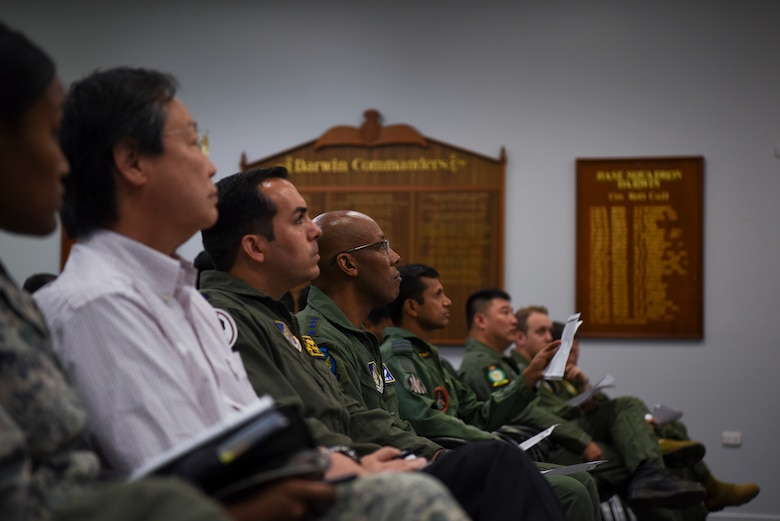 U.S. Air Force Gen. CQ Brown, Jr., Pacific Air Forces commander, observes an Exercise Pitch Black 2018 mission commander's brief, at Royal Australian Air Force Base Darwin, Australia, Aug. 13, 2018. Brown visited the exercise to see firsthand the U.S. involvement in the region and the witness the integration with the 15 other participating nations from across the world. (U.S. Air Force Photo by Senior Airman Savannah Waters)