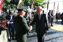 Defense Secretary James N. Mattis shakes hands with a Brazilian defense official.