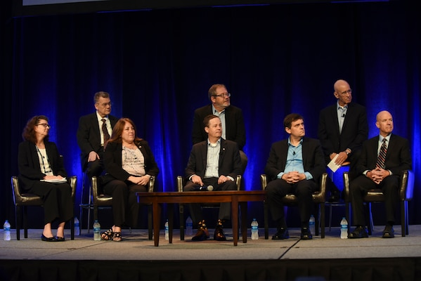 Data officers from across the IC discuss the need to move data and information within the agencies to central databases and make it more readily available across the community during the DoDIIS Worldwide Conference, Aug. 14, 2018, in Omaha, Nebraska.