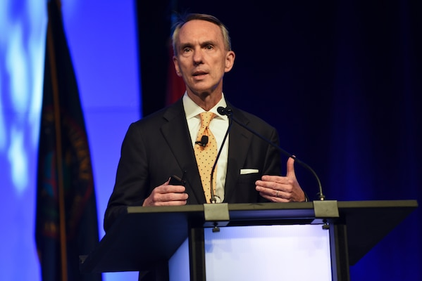 Andrew Hallman, deputy director of CIA for digital innovation, talks about optimizing the intelligence community, as well as developing and maturing digital platforms during the 2018 DoDIIS Worldwide Conference, Aug. 14, 2018, in Omaha, Nebraska.