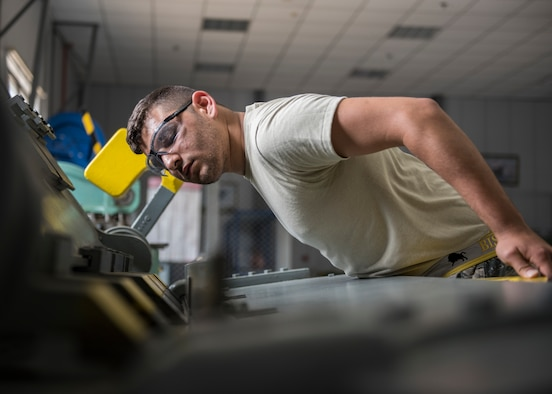 U.S. Air Force Senior Airman Dustin Pace, 39th Maintenance Squadron aircraft structural maintenance member, bends metal at Incirlik Air Base, Turkey, Aug. 7, 2018.