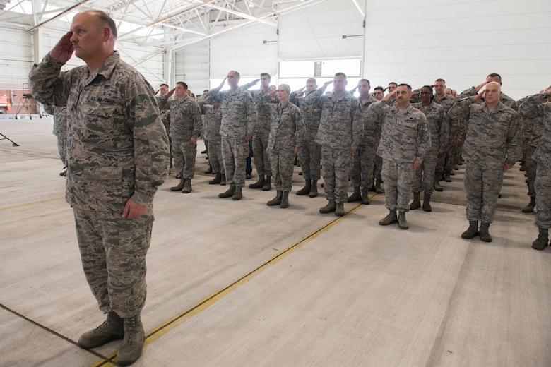 Col. Rodney Neely, 167th Airlift Wing vice commander, leads the wing in a final salute to Col. Shaun Perkowski, during a change of command ceremony Aug. 5, at the Martinsburg, W.Va. air base. Col. David Cochran assumed command from Perkowski during the ceremony. (U.S. Air National Guard photo by Senior Master Sgt. Emily Beightol-Deyerle)