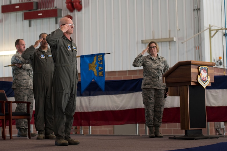 Col. Shaun Perkowski, outgoing commander of the 167th Airlift Wing, renders a salute during a change of command ceremony Aug. 5, at the Martinsburg, W.Va. air base. Col. David Cochran assumed command from Perkowski during the ceremony. (U.S. Air National Guard photo by Tech. Sgt. Jodie Witmer)