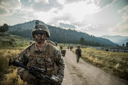 Pfc. Alejandro Lazcano, a rifleman with India Company, 3rd Battalion, 5th Marine Regiment, 1st Marine Division, participates in a hike during Mountain Training Exercise 4-18 aboard Mountain Warfare Training Center Bridgeport, Calif., July 30, 2018.