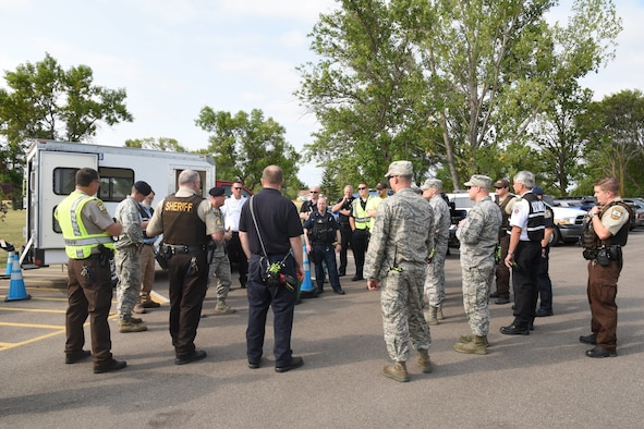 Grand Forks Air Force Base and local law enforcement rally to discuss events of an active-shooter exercise August 14, 2018, on Grand Forks Air Force Base, North Dakota. The exercise was a collaborative effort between the Grand Forks AFB law enforcement and medical units, Grand Forks County law enforcement, and the Grand Forks Public School administration. (U.S. Air Force photo by Senior Airman Elijaih Tiggs)