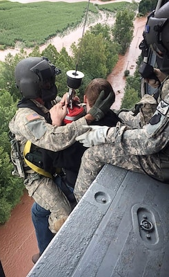 U.S. Soldiers with the 28th Expeditionary Combat Aviation Brigade, Pennsylvania Army National Guard, rescue a person stranded by flooding near Benton, Pennsylvania, Aug. 13, 2018.