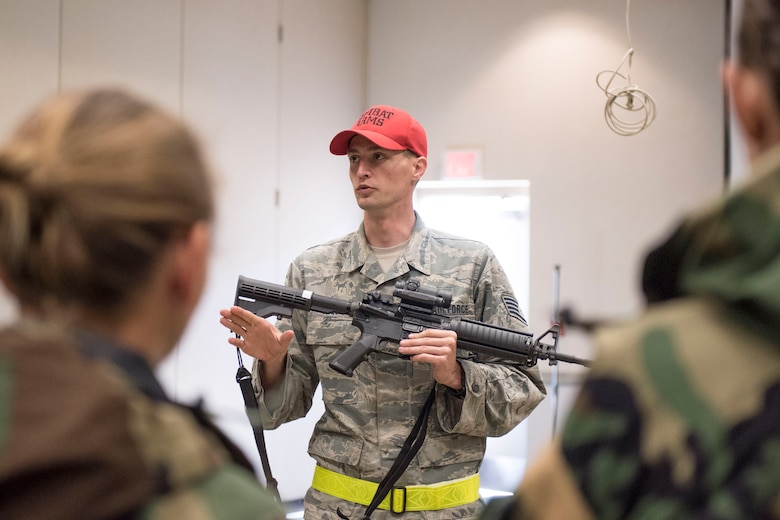 Master Sgt. Brian Fuqua, a combat arms instructor for the 167th Security Forces Squadron, leads a refresher class on proper M-16 handling and care during a deployment training exercise at the Alpena Combat Readiness Training Center in Michigan, June 10-14, 2018. Approximately 200 members of the 167th Airlift Wing participated in the event. (U.S. Air National Guard photo by Tech. Sgt. Jodie Witmer)