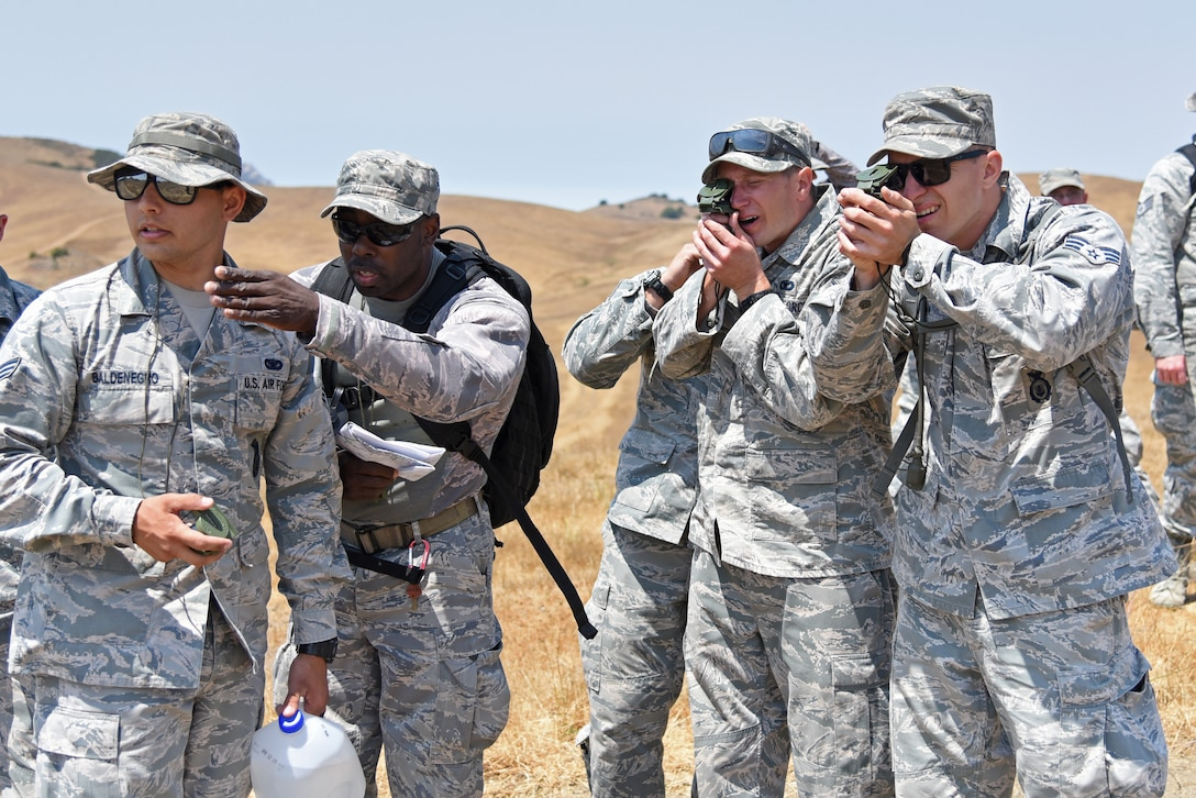 U.S. Air National Guardsmen read the azimuth of a distant marker as part of the land-navigation portion of their annual training at Camp San Luis Obispo, California, Aug. 7, 2018. The 10-day annual-training exercise brought together Security Forces members from four Air National Guard units in Arizona and Illinois to improve weapons, land navigation, and tactical movement skills. (U.S. Air National Guard photo by Staff Sgt. Dillon Davis)