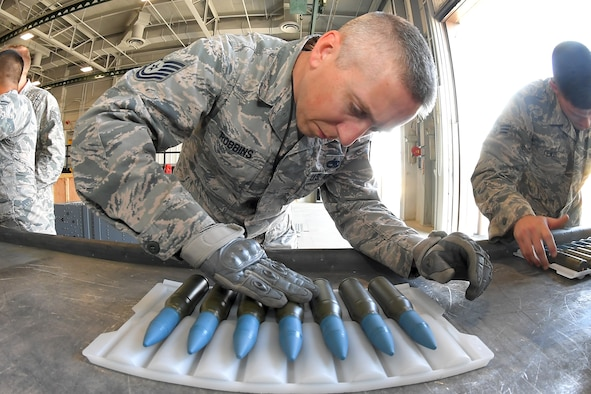Tech. Sgt. Ross Robbins, 419th Maintenance Squadron, inspects 25 mm target practice rounds in preparation for loading into F-35 magazines August 8, 2018 at Hill Air Force Base, Utah. The F-35A is the only F-35 variant with an internal cannon. It is capable of firing 50 rounds per second. (U.S. Air Force photo by Todd Cromar)