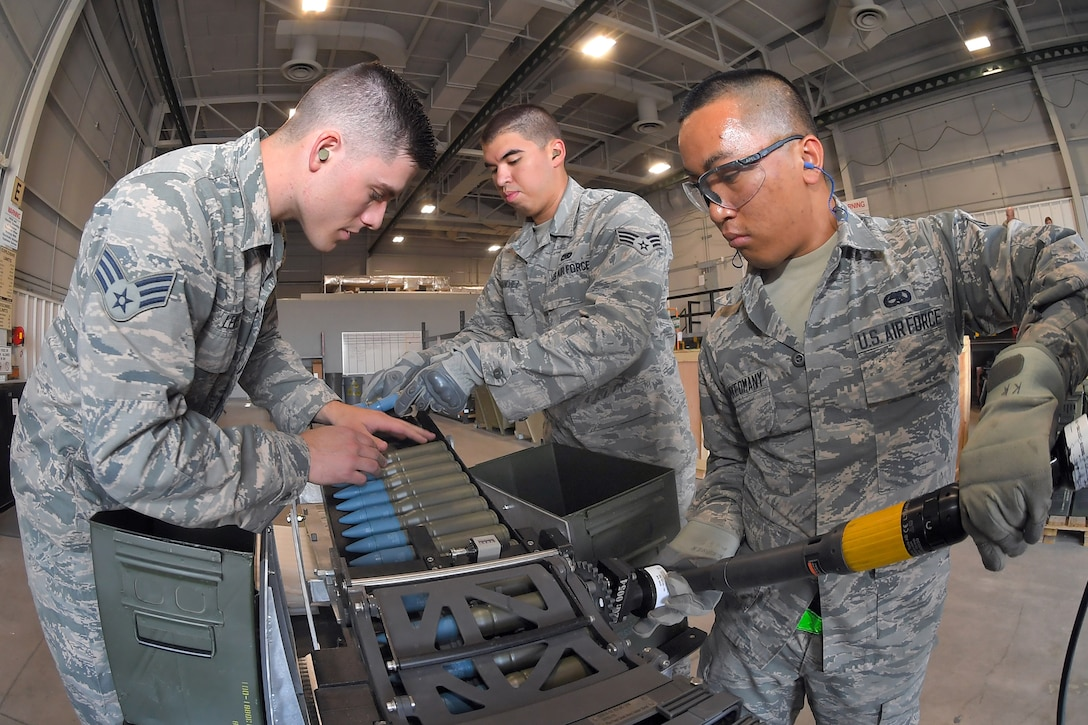 Senior Airman Bradley Lewis, Senior Airman Nicholas Sanchez, and Airman 1st Class James Khamkeomany, 388th Maintenance Squadron, load 25 mm target rounds into F-35 magazines August 8, 2018, Hill Air Force Base, Utah. The training was in preparation for the first operational loading of the F-35A cannon. (U.S. Air Force photo by Todd Cromar)