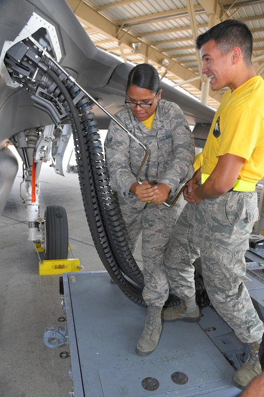 Airman 1st Class Emily Villela and Airman Baltazar Enriquez, 4th Aircraft Maintenance Unit, accomplish the first-time operational loading of 25 mm target rounds in an F-35A Lightning II,  Aug. 10, 2018, at Hill Air Force Base, Utah. (U.S. Air Force photo by Todd Cromar)