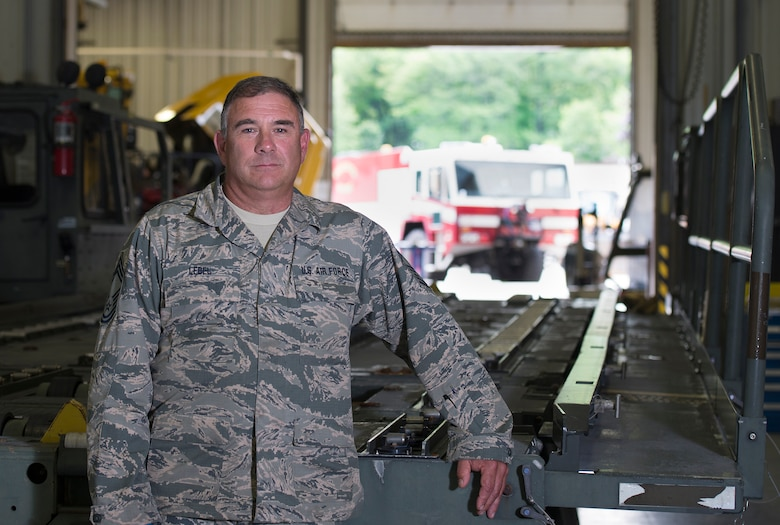 Chief Master Sgt. Anthony M. Lebel, the vehicle fleet manager assigned to the 157th Mission Support Group, poses for a portrait on July 26, 2018 at Pease Air National Guard Base, N.H. Lebel is scheduled to retire on August 11, 2018, after more than 35 years of service. (N.H. Air National Guard photo by Staff Sgt. Kayla White)