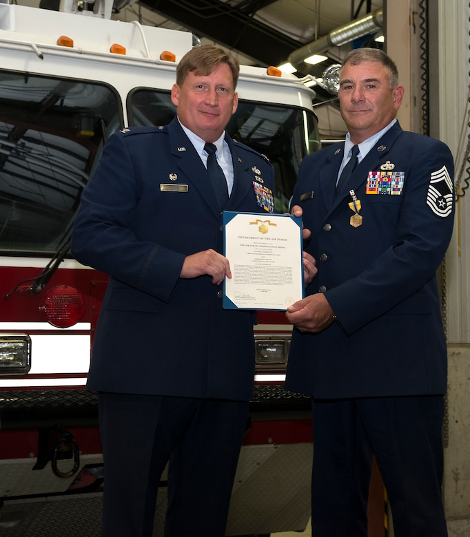 Chief Master Sgt. Anthony M. Lebel, vehicle fleet manager assigned to the 157th Mission Support Group, receives his retirement certificate from Col. Christopher W. Hurley, commander of the 102nd MSG, Vermont Air National Guard, during a ceremony on Aug. 11, 2018 at Pease Air National Guard Base, N.H. Lebel joined the Air Force  in 1983 and retired after more than 35 years of service. (Photo by Staff Sgt. Kayla White, 157th Air Refueling Wing Public Affairs)