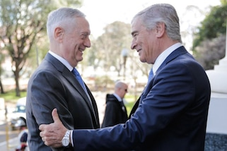 Defense Secretary James N. Mattis embraces Argentinian Defense Minister Oscar Aguad.