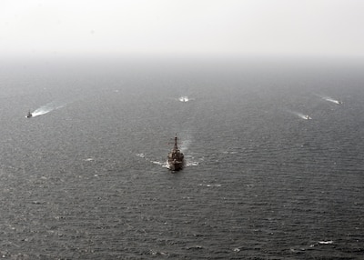 Guided-missile destroyer USS The Sullivans (DDG 68) leads a formation of ships, including Cyclone-class patrol crafts USS Tempest (PC 2) and USS Chinook (PC 9), U.S. Coast Guard Island-class patrol cutter USCGC Monomoy (WPB 1326), a Kuwaiti naval vessel and an Iraqi naval vessel during a trilateral exercise with Iraq and Kuwait. The exercise is a surface engagement between the U.S. Navy and Coast Guard, and the Iraqi and Kuwaiti navies focused on improving proficiency in maritime security tactics to help ensure the freedom of navigation throughout the U.S. 5th Fleet area of operations. (U.S. Navy Photo by MC2 Lucas Askew/Released)