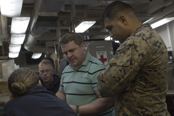 Sam Pratt, an engineer with Naval Sea Systems Command, discusses the capabilities of 3-D printing with service members aboard the USS Wasp (LHD-1) while underway in the Pacific Ocean, April 7, 2018. Marines with Combat Logistics Battalion 31, 31st Marine Expeditionary Unit, are now capable of ~additive manufacturing, also known as 3-D printing, which is the technique of replicating digital 3-D models as tangible objects. The 31st MEU partners with the Navy's Amphibious Squadron 11 to form the Wasp Amphibious Ready Group, a cohesive blue-green team capable of accomplishing a variety of missions across the Indo-Pacific.