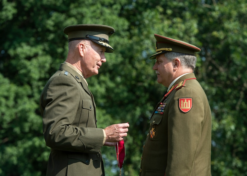 Marine Corps Gen. Joe Dunford, the chairman of the Joint Chiefs of Staff, hosts his Lithuanian counterpart Lt. Gen. Jonas Vytautas Žukas at an honors ceremony on Whipple Field at Fort Myer, Va., Aug. 15, 2018. During the ceremony Dunfored presented Žukas with a Legion of Merit award for service to his country. DoD photo by Navy Petty Officer 1st Class Dominique A. Pineiro