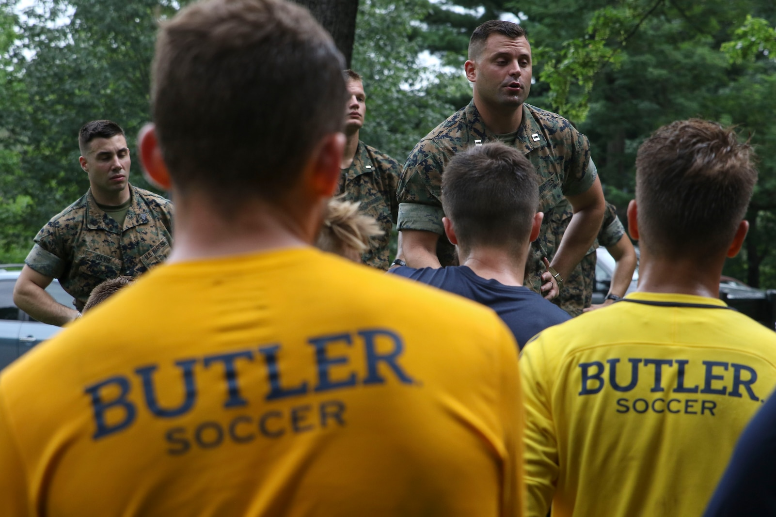 INDIANAPOLIS - Marine Corps Officer Candidates School candidates and Butler University men's soccer team participate in a leadership and cohesion exercise August 15, 2018, at the Fort Harrison State park in Indianapolis. The training allowed the students from the university to experience physical training the Marine Corps way and allowed the Marines to share their leadership style. The exercise also allowed the teams to build cohesion amongst each another. (U.S. Marine Corps photos by Sgt. Carl King)