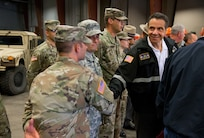 New York Gov. Andrew M. Cuomo greets members of the new York Army National Guard's 204th Engineer Battalion who were on duty to respond to heavy flooding the in New York's Finger Lakes and Southern Tier regions on Tuesday, August 14,2018 in Vestal, N.Y. The governor declared a disaster area in 14 counties and mobilized 200 New York National Guard Airmen and Soldiers as part of the state response.