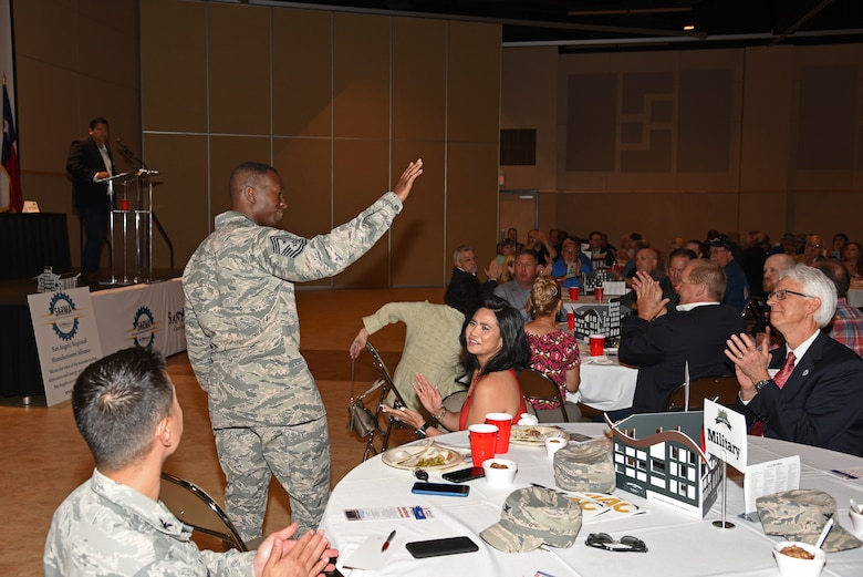 U.S. Air Force Chief Master Sgt. Lavor Kirkpatrick, 17th Training Wing command chief, greets attendees at the San Angelo Chamber of Commerce luncheon at the McNease Convention Center in San Angelo, Texas, Aug. 14, 2018. Kirkpatrick and Col. Robert Ramirez, 17th TRW vice commander, attended the event to introduce themselves to community members. (U.S. Air Force photo by Staff Sgt. Joshua Edwards/Released)