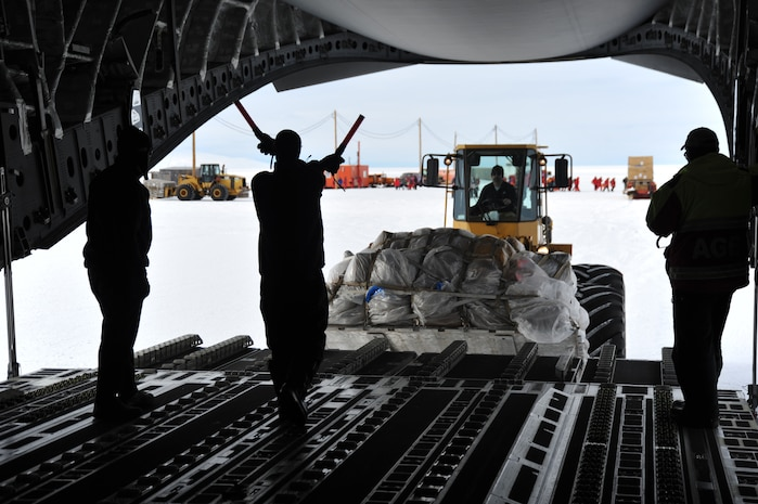 Cargo is loaded onto a C-17 Globemaster III on Feb. 6, 2018, near McMurdo Station in Antarctica. Members of the 304th Expeditionary Airlift Squadron operated aircraft while supporting the U.S. Antarctic Program through Operation Deep Freeze. (Courtesy Photo)