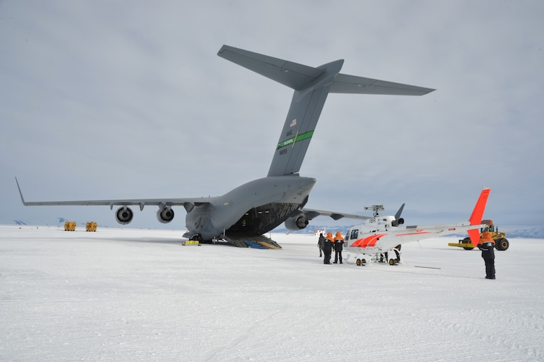 A Bell 212, operated by Antarctic New Zealand, is prepared to be loaded onto a C-17 Globemaster III Feb. 17, 2018 near McMurdo Station in Antarctica. Members of the 304th Expeditionary Airlift Squadron operated aircraft while supporting the U.S. Antarctic Program through Operation Deep Freeze. (Courtesy Photo)