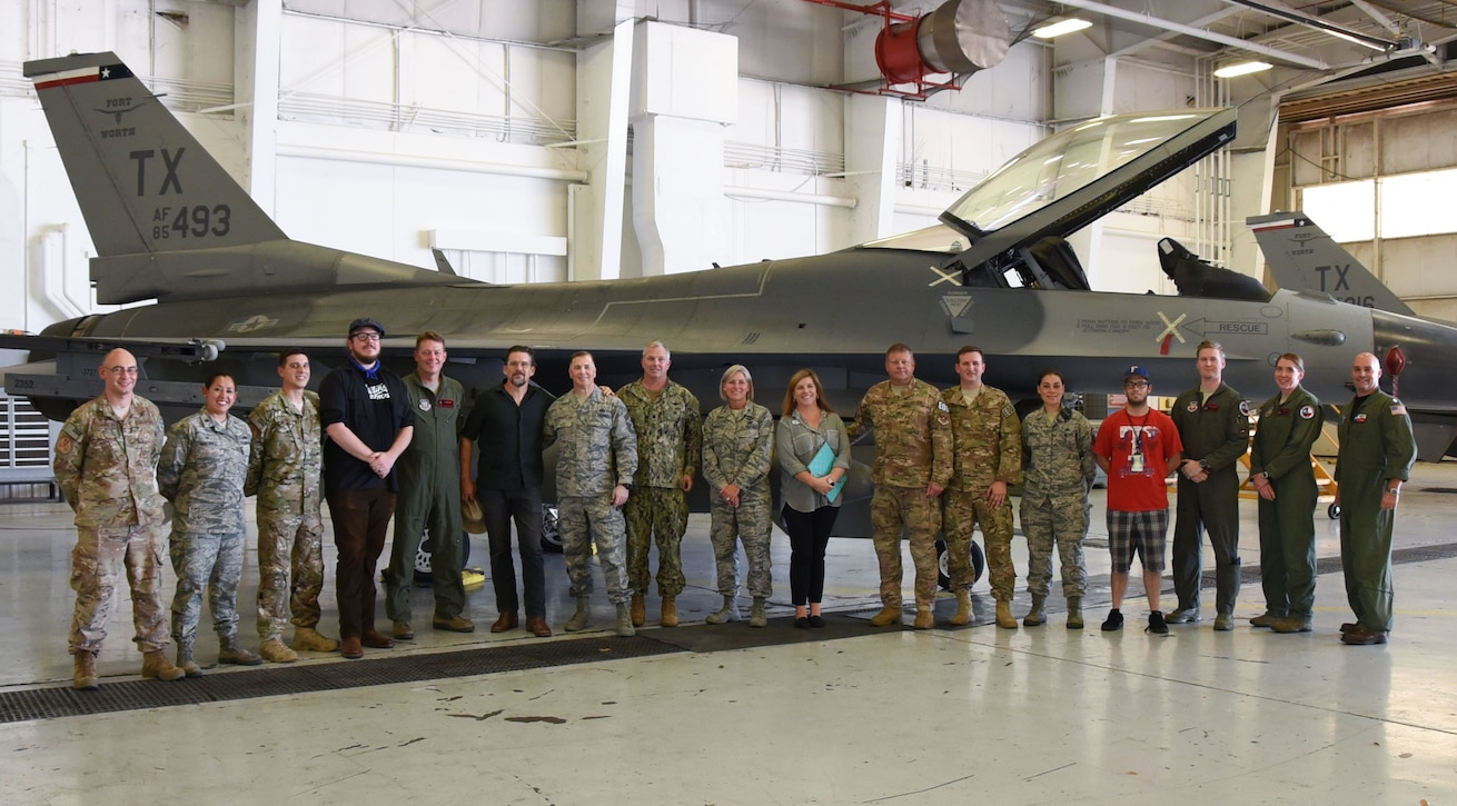 Director and Oscar-nominated actor Ethan Hawke and fellow actor and musician Ben Dickey visit the 301st Fighter Wing, Aug. 15, 2018. The two visited Naval Air Station Fort Worth Joint Reserve Base, Texas to premiere their latest movie, Blaze, for service members and their families. (U.S. Air Force photo by Melissa Harvey) (This photo has been altered for security purposes by blurring an identification badge.)