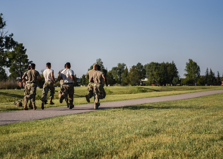 Airman from the 890th Missile Security Forces Squadron on F.E. Warren Air Force Base, Wyo. start an 880 yard run as part of the U.S. Marine Corps Combat Fitness Test Aug. 9, 2018. The test consists of three events: an 880-yard run in boots and utility uniforms, ammo can lifts and a maneuver-under-fire obstacle course. (U.S. Air Force photo by Airman 1st Class Braydon Williams)