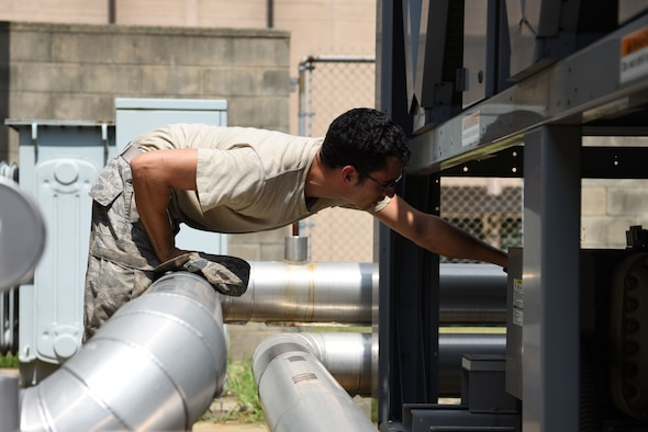 U.S. Air Force Senior Airman Frank Galambos, 51st Civil Engineer Squadron heating, ventilating and air conditioning journeyman, checks a cooling unit for one of the dorms at Osan Air Base, Republic of Korea, Aug. 13, 2018. With 42 members – 24 military and 18 civilian – assigned to the HVAC flight, they were able to close approximately 1,500 work orders in three months. (U.S. Air Force photo by Senior Airman Kelsey Tucker)
