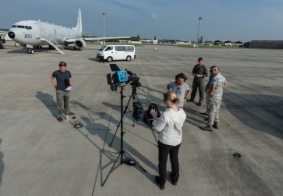 A news team from CNN prepares to go live after a flight on a U.S. Navy P-8A Poseidon Aug. 10, 2018, at Kadena Air Base, Japan. News agencies were invited to fly on the P-8A to learn about the Poseidon's abilities and the role it plays in the Pacific region. (U.S. Air Force photo by Staff Sgt. Micaiah Anthony)