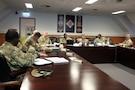 Soldiers in meeting