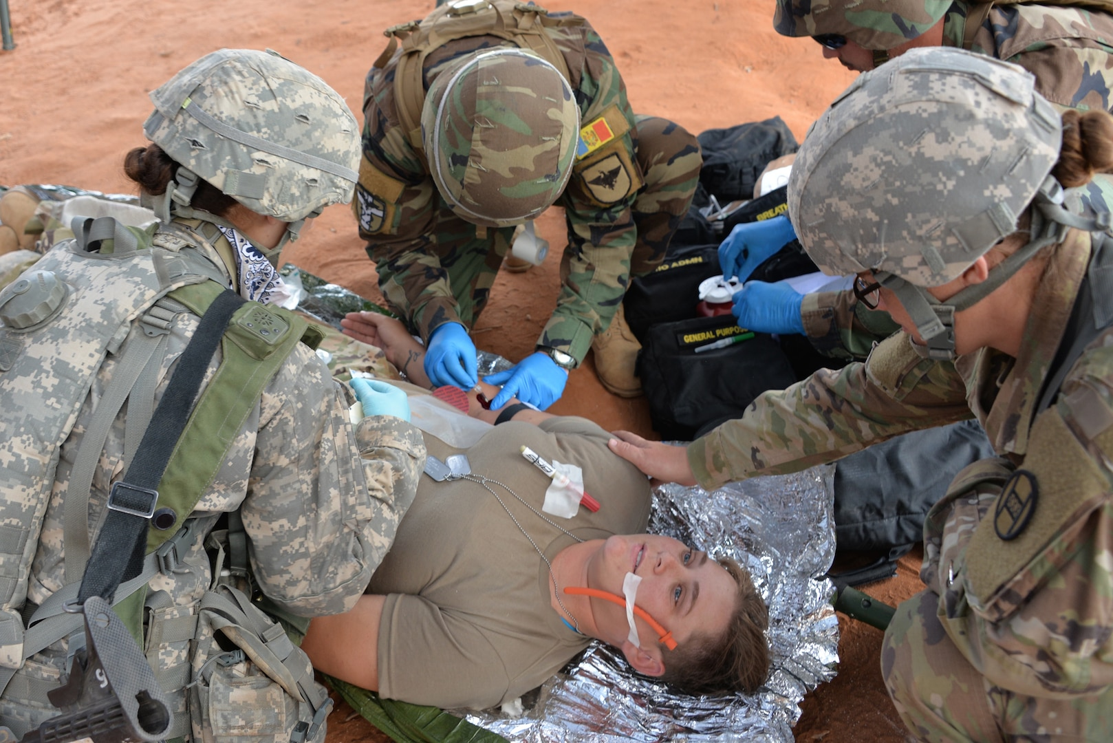 Combat medic soldiers with the 230th Brigade Support Battalion and Moldovan Combat Medics work together conducting life-like combat casualty care training with Soldiers injured in the battlefield.  Soldiers train on medical technique and medical intervention at a training area near Ft. Bliss, Texas, during the 30th Armored Brigade's eXportable Combat Training Capability (XCTC) exercise, August 6 – 21, 2018.