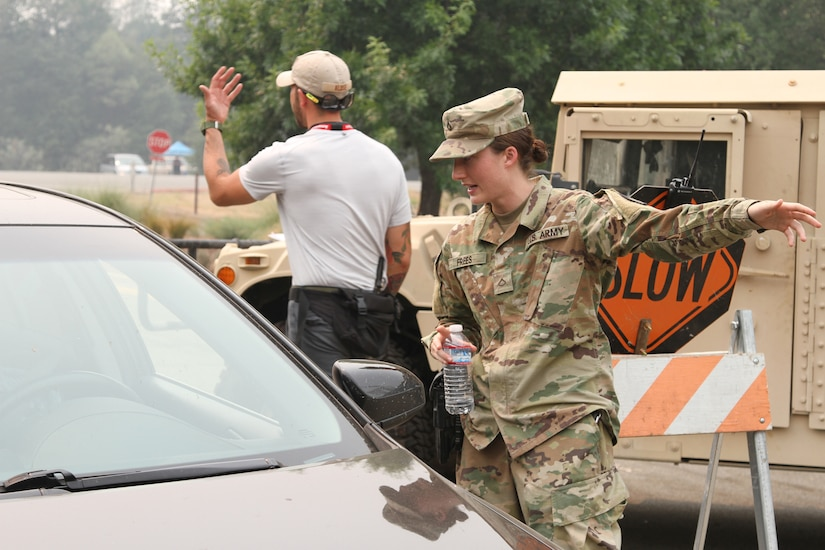National Guard soldier talks with a motorist.