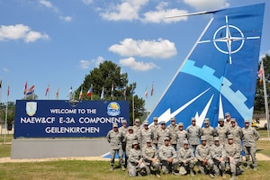 The 442d Medical Squadron poses for a photo in front of the welcome sign at NATO Air Base Geilenkirchen, Germany, June 28, 2018.