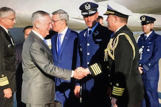Defense Secretary James N. Mattis shakes hands with a Chilean military official in Santiago.
