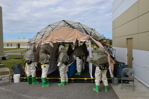 The Icemen of the 354th Medical Group conducted an extensive training exercise encompassing hands-on Self-Aid Buddy Care, litter carries, and patient decontamination, July 25, 2018.