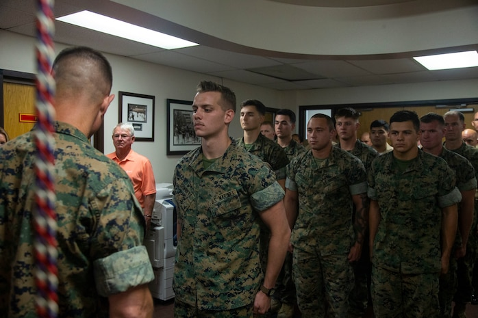 Lance Cpl. Dillon Bennett, machine gunner, 3rd Battalion, 7th Marine Regiment, receives a Purple Heart from Col. Kyle B. Ellison, commanding officer, 7th Marine Regiment, at 7th Marines' Headquarters aboard the Marine Corps Air Ground Combat Center, Twentynine Palms, Calif., July 27, 2018. Bennett received the Purple Heart for wounds sustained while deployed to his area of operations on July 9, 2018. (Marine Corps photo by Lance Cpl. Dave Flores)