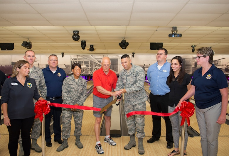 Col. Thomas P. Sherman, 88th Air Base Wing commander, and Mike Hellmann, Wednesday After Thoughts Bowling League secretary cut the ceremonial ribbon for the Wright-Patterson Air Force Base, Ohio, Bowling Center Aug. 13, 2018.