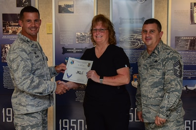 """Julie Lalich, 47th Medical Support Squadron pharmacy technician, was chosen by wing leadership to be the """"XLer"""" of the week, for the week of Aug. 6, 2018, at Laughlin Air Force Base, Texas. The """"XLer"""" award, presented by Col. Charlie Velino, 47th Flying Training Wing commander, is given to those who consistently make outstanding contributions to their unit and the Laughlin mission. (U.S. Air Force photo by Airman 1st Class Marco A. Gomez)"""