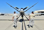 Members of the 163d Aircraft Maintenance Squadron,163d Attack Wing, California Air National Guard, conduct a preflight check on the wing's MQ-9 Reaper remotely piloted aircraft before a fire support mission, Aug. 1, 2018, at March Air Reserve Base, California. The wing is supporting state agencies that are battling numerous wildfires in Northern California, including the Carr Fire and Mendocino Complex Fire.