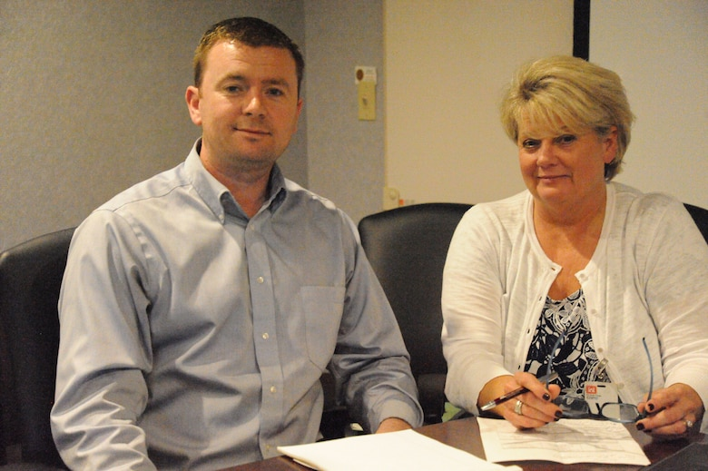 Jason Walsh, Huntsville Center safety specialist, and Brenda Miller, U.S. Army Combat Readiness Center senior safety adviser and Career Program-12 functional chief representative, take a moment to pose for a photo during Miller's visit to the Center Aug. 14. Walsh was one of 25 safety careerists to receive the Army Emerging Safety Leader Award.