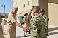 Petty Officer 1st Class Joaquin Cruz (right), an instructor at the Medical Education and Training Campus, greets Vice Adm. Forrest Faison, Navy surgeon general and chief, U.S. Navy Bureau of Medicine and Surgery during his visit to Navy Medicine Training Support Center at Joint Base San Antonio-Fort Sam Houston.