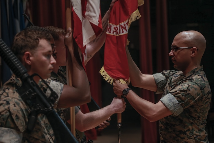 Col. Gregory Poland, left, receives the unit colors for Marine Corps Tactics and Operations Group from Col. Timothy Barrick, signifying the change of command for the unit during the 10th anniversary ceremony of MCTOG aboard the Marine Corps Air Ground Combat Center, Twentynine Palms, Calif., Aug. 10th, 2018. MCTOG celebrated its 10th anniversary and conducted a change of command ceremony during which Barrick relinquished command of MCTOG to Poland. (U.S. Marine Corps photo by Lance Cpl. Preston L. Morris)