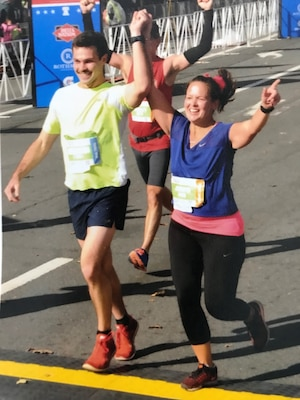 DLA Troop Support Clothing and Textiles acquisition specialist Aaron Jones, left, and contracting officer Jennifer Scarpello complete the Philadelphia Marathon November 19, 2017. Jones and Scarpello work on C&T's individual equipment team and used the DLA Wellness Program to help train for the marathon and other long distance races.