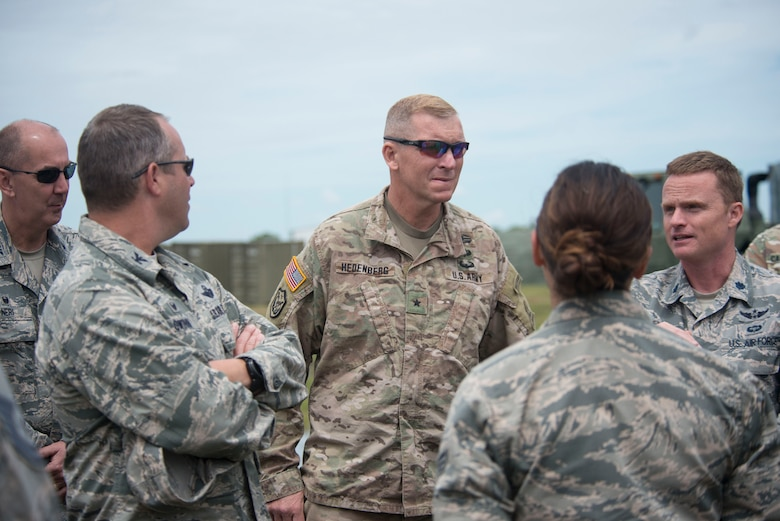 Connecticut Army and Air National Guard senior leaders discuss the AN/TYQ-23A Tactical Air Oper-ations Module (TAOM). Senior leaders pictured (from left to right), Col. Bill Neri, 103rd Mission Support Group Commander, Col. Stephen Gwinn, 103rd Airlift Wing Commander, Brig. Gen. Ralph Hedenberg, Connecticut National Guard Director Joint Staff, and Lt. Col. John Sorgini, 103rd Air Control Squadron Commander. (Air National Guard photos by Tech. Sgt. Tamara R. Dabney)
