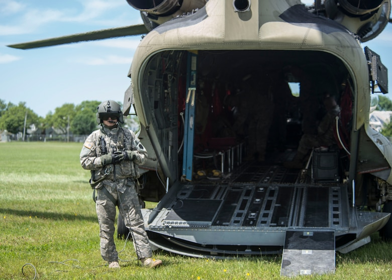 A Connecticut Army National Guard aviation specialist prepares to usher passengers onto a CH-47 Chinook during an annual training exercise, June 11, 2018 in Sea Girt, N.J. (Air National Guard photo by Tech. Sgt. Tamara R. Dabney)