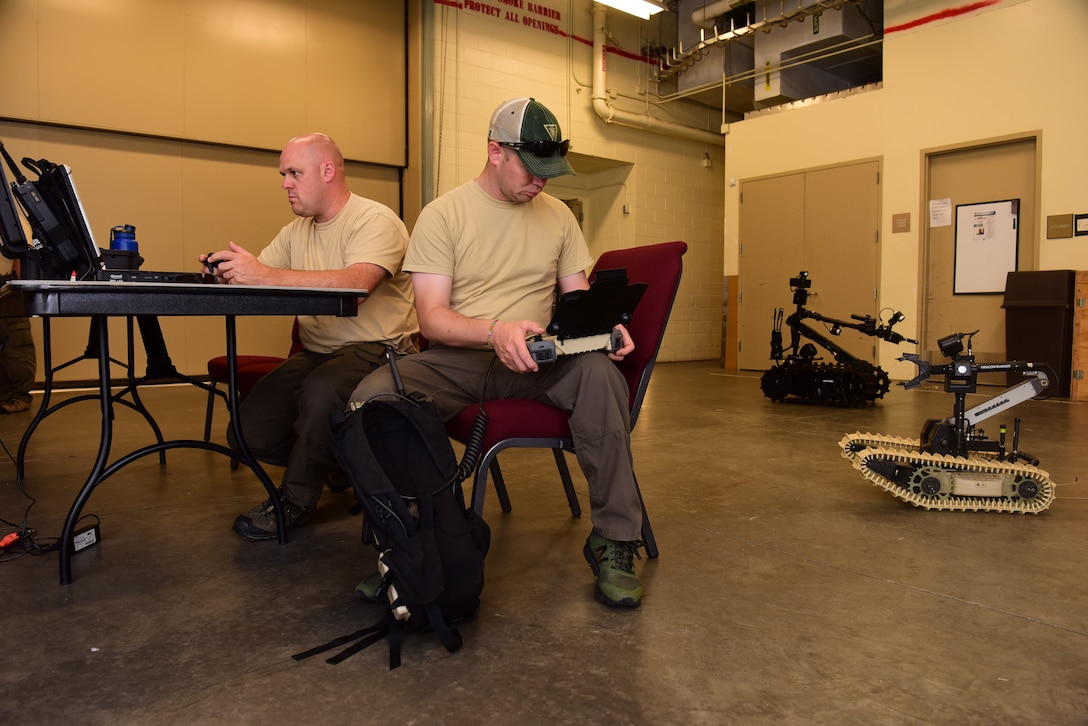 Mike Ward, left, New Jersey State Police Bomb Unit detective, and Joe Byra, NJSP detective, operate ordnance disposal robots during the 2018 Eastern National Robotics Rodeo at the at the Charleston convention center in Charleston S.C. Aug. 13, 2018, in Charleston, S.C.